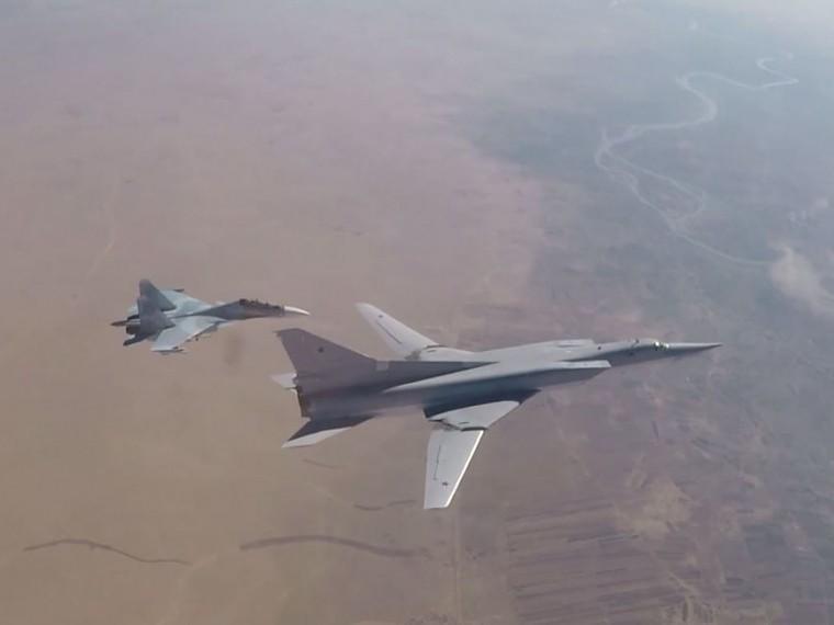 Минобороны опубликовало кадрыразрушительного авиаудара попозициям ИГИЛ* вСирии